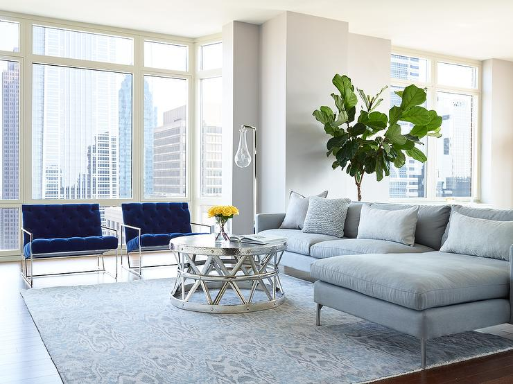 Gray Sofa with Chaise Lounge and Blue Velvet Accent Chairs .