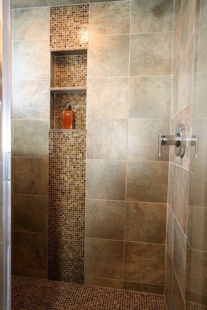 I like when they use accent tile in the vertical. shower ideas .