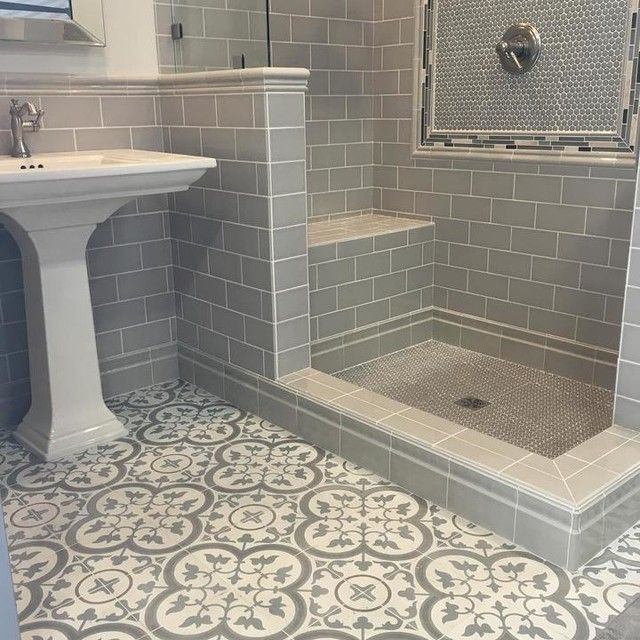 Modern hexagon and subway tile shower with a muted Spanish .