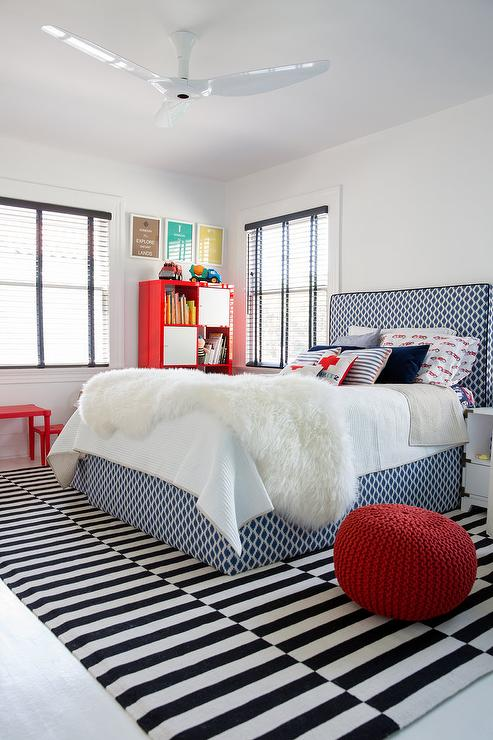 Blue Geometric Fabric Kid Bed with Black and White Striped Rug .