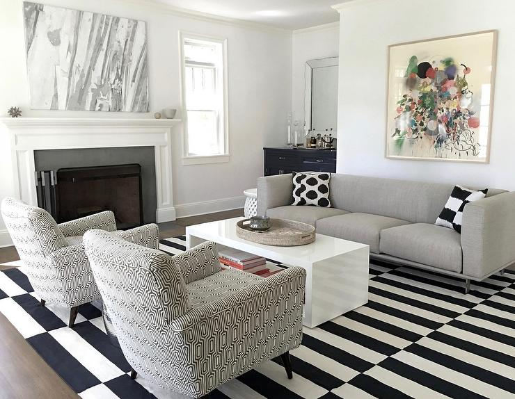 Gray Modern High Back Sofa with Black and White Pillows .