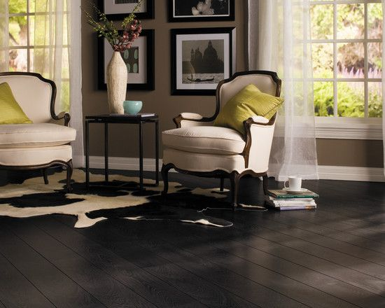 Dark laminate flooring in this black and white room with a few .