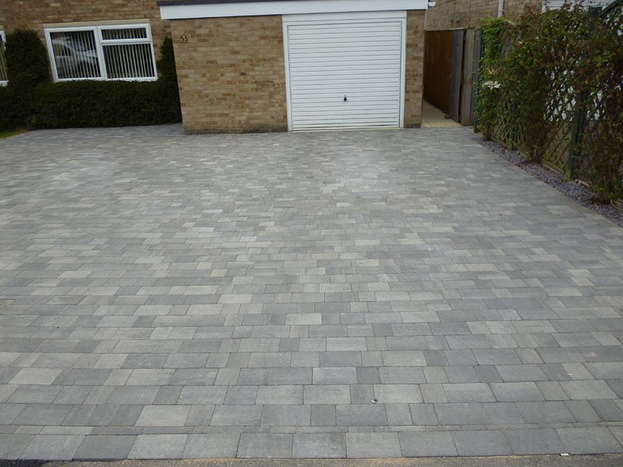 This large modern block paved driveway was created by AWBS .