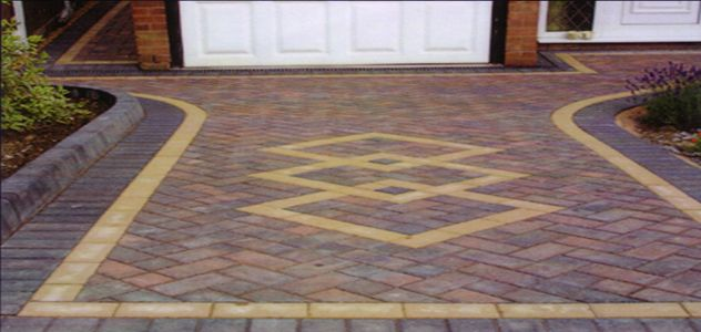 Small block paved driveway with an interlocking diamond shaped .
