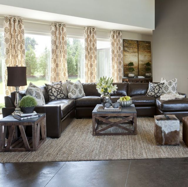 Sectional in center instead of against the walls. Dark couch and .