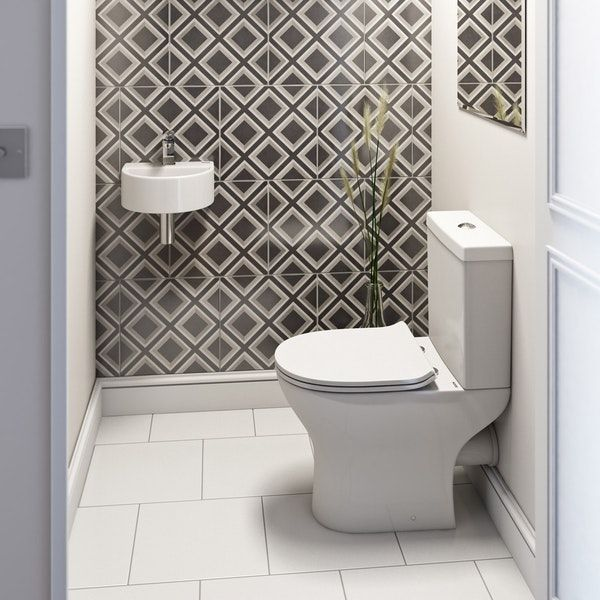 Orchard Compact cloakroom suite with contemporary wall hung basin .