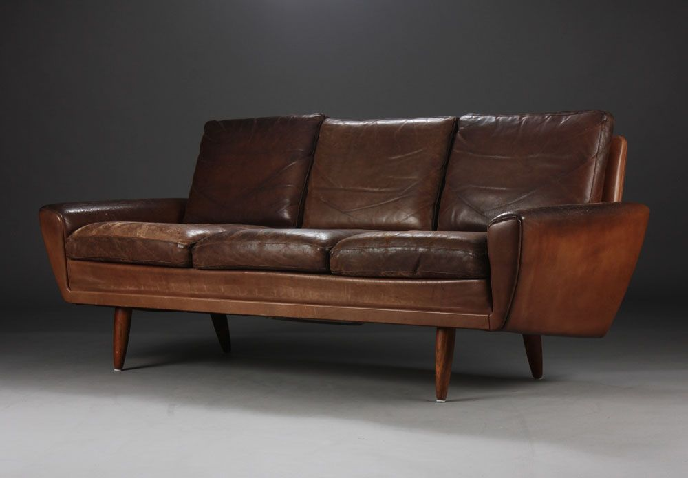 Three-seater, brown leather, Danish furniture producer from 1960 .