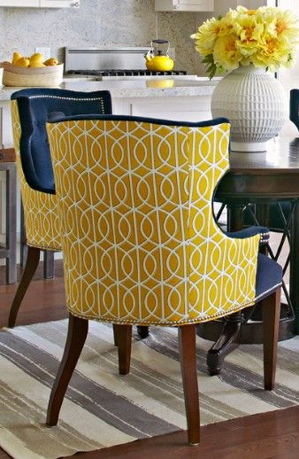 chairs upholstered in two different fabrics can have real pop .