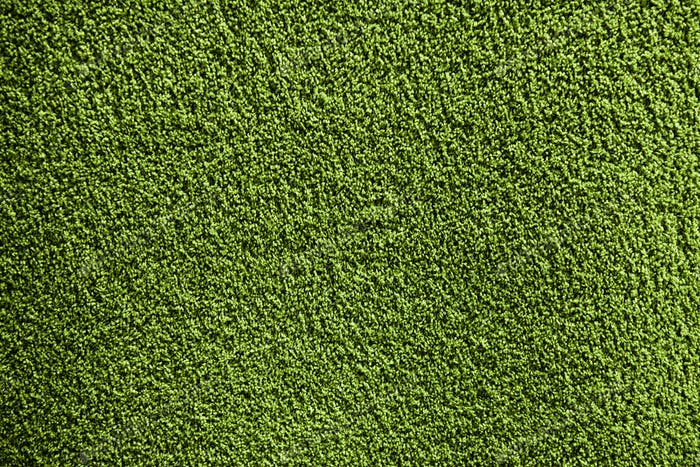 Artificial green carpet texture close-up background photo by .