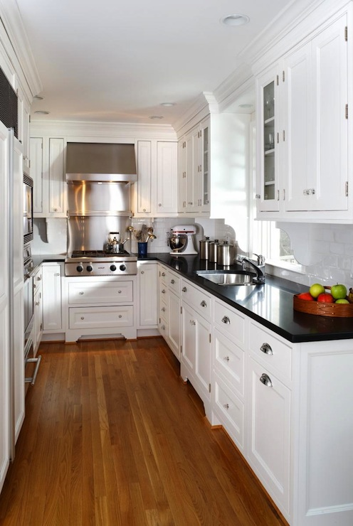 White Kitchen Cabinets with Black Countertops - Traditional .