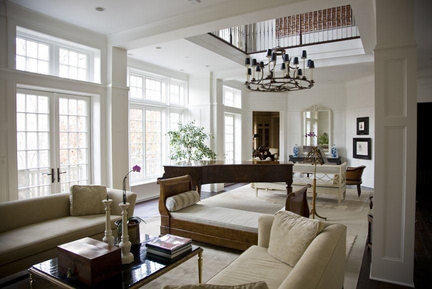 A large chandelier anchors the double height ceilings in this .