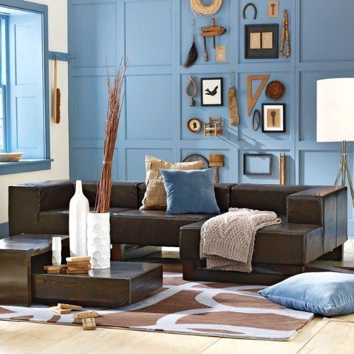 Light Blue Accent Wall and Dark Brown Leather Couch - Living Room .