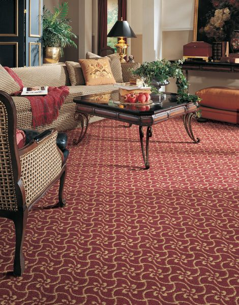Red and cream patterned carpet in living room | Patterned carpet .