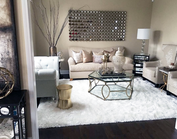 My formal living room with copper accents and white faux fur rug .