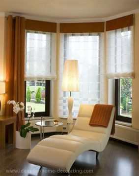 Modern bay window curtains with sheer voile roman blinds .