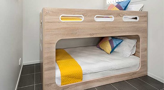 Modern bunk beds in the Riverfront cabins - Picture of Tomaga .