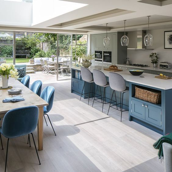 Open plan kitchen-diner with blue island and cabinetry   Open plan .