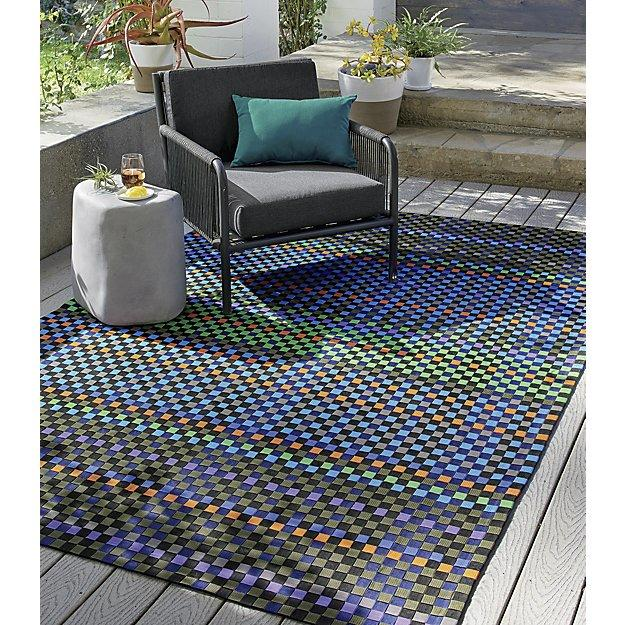 Get Outside! 6 Outdoor Area Rug Options to Make Your Deck Shi
