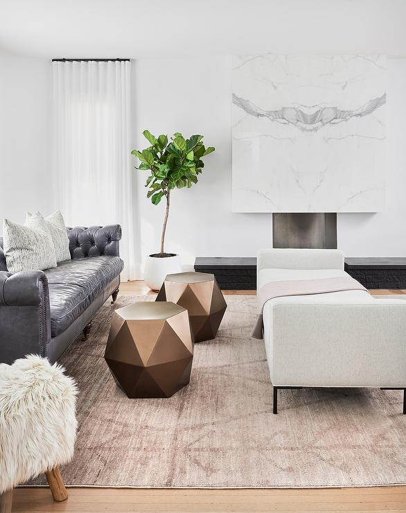 Steel Gray Leather Chesterfield Sofa with Blush Pink Rug .