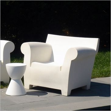 The Bubble Chair -- designed by Philippe Starck and made of white .
