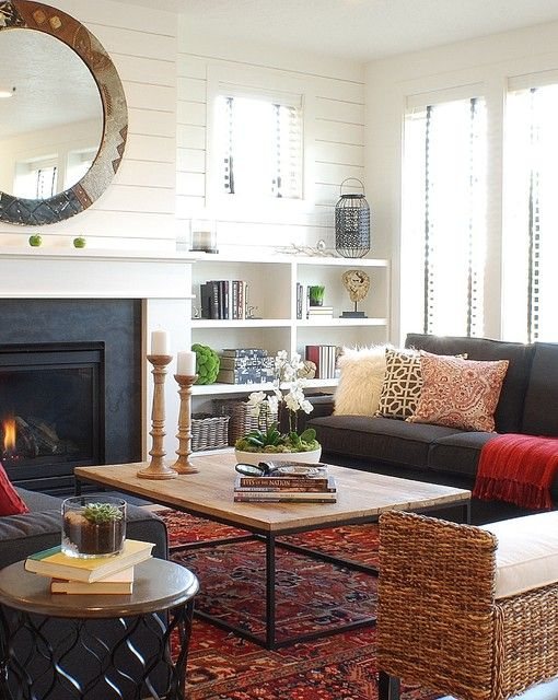 farmhouse living room With Black Sofa and Fireplace red Rug Carpet .