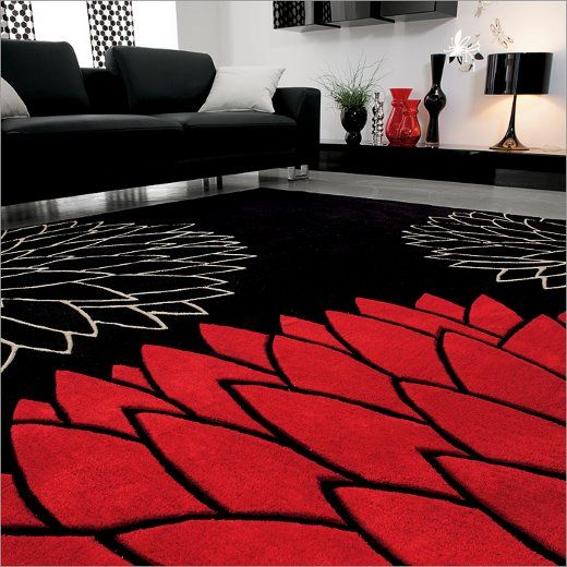 This room is colored in black and white with red as an accent .