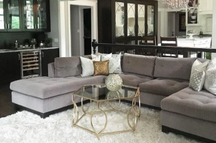 Gray sectional, black built ins and white shag rug | Rugs in .