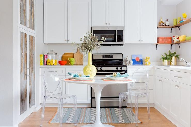 Small Kitchen with Round Table and Ghost Chairs - Transitional .