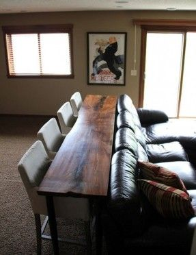 For the basement - table behind the couch with bar-stools. Perfect .