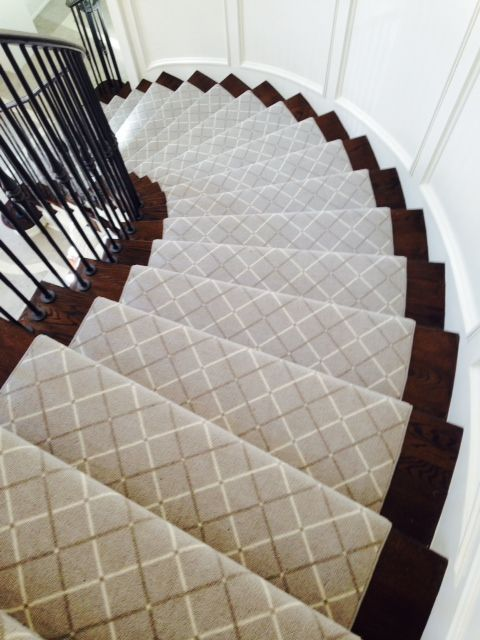 This classic stair runner looks perfect on this traditional curved .