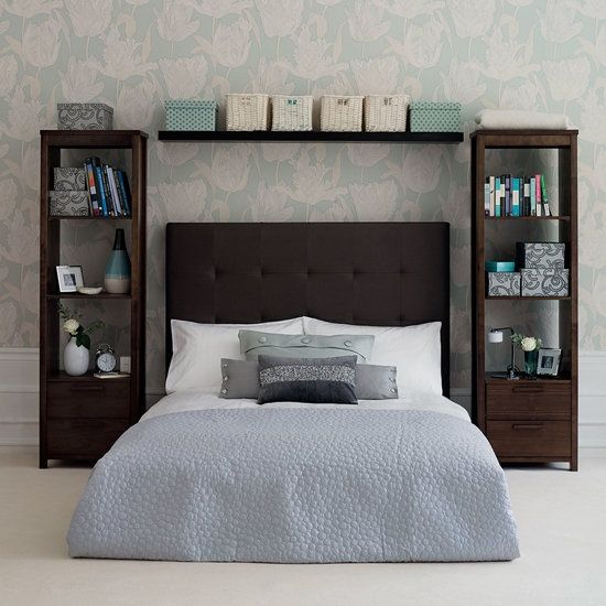 Tall bookshelves instead of a nightstand! Genius! I love the shelf .