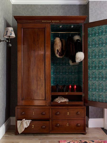 Antique armoire lined in printed cotton by Violet & George .