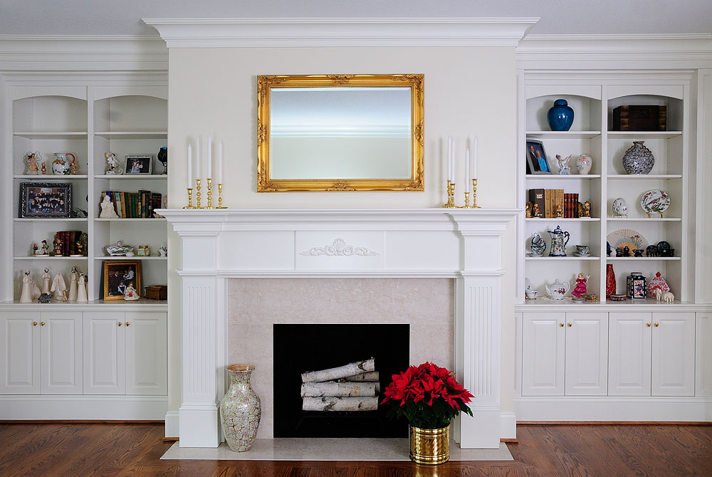White fireplace with surrounding bookcases - Custom Cabinetry by .