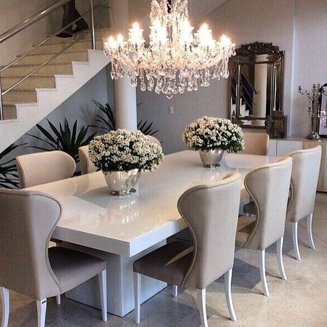 Sleek white table with ivory/beige dining chairs, top off the .