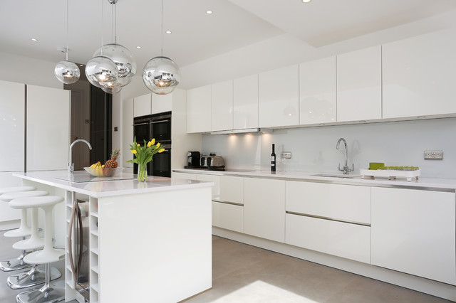 White gloss island kitchen - Contemporary - Kitchen - London - by .
