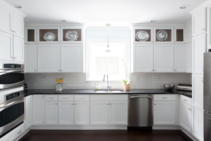 White Kitchen Cabinets with Black Countertops - Transitional .