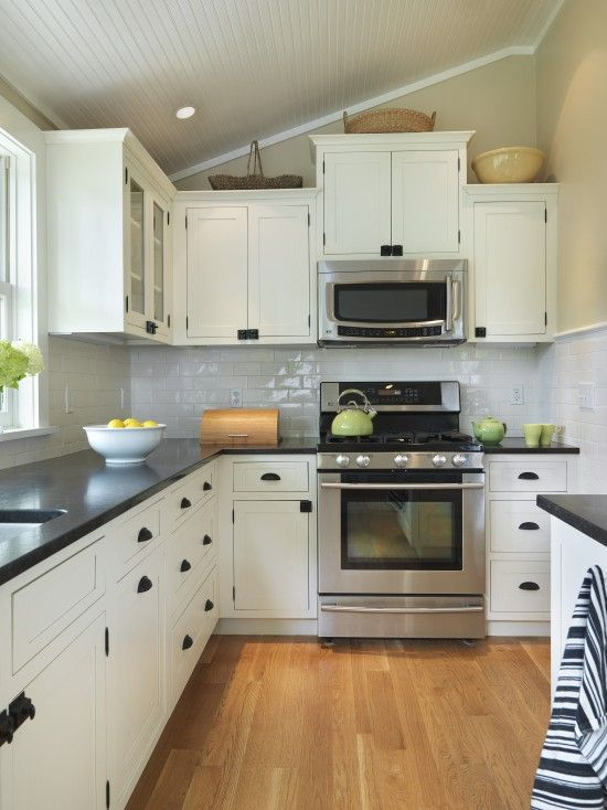 White Cabinets With Black Countertop Design. Love the door/drawer .