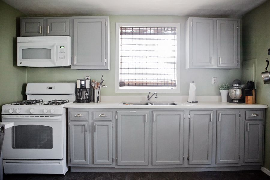 Gray cabinets, green walls, white appliances. Cabinets are painted .