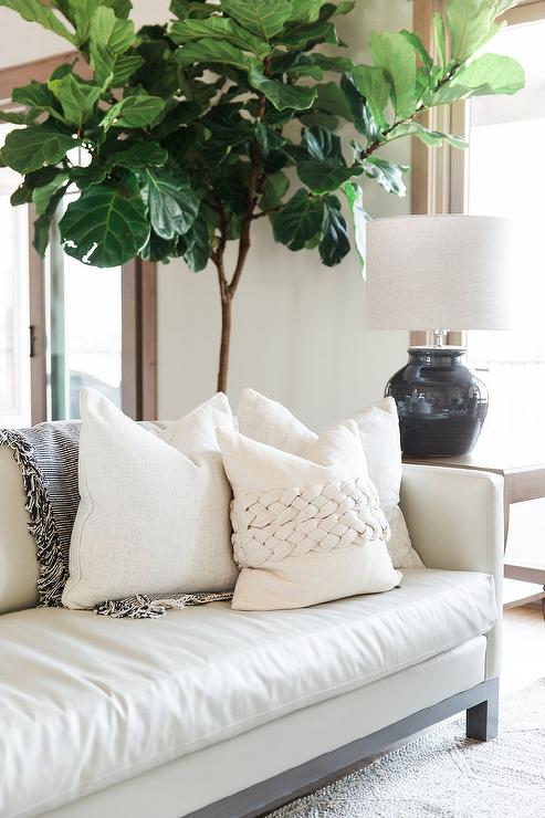 Chic White Leather Sofa with White Pillows - Transitional - Living .
