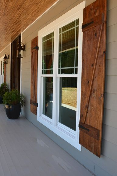 Front porch with custom ceiling, cedar posts, stone columns and .